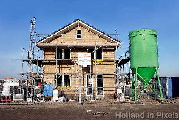Huis in Aanbouw  ( namen van bedrijven zijn met behulp van photoshop verwijderd )
