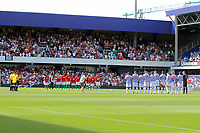 FAO SPORTS PICTURE DESK<br /> Pictured: Both teams pay tribute before kick off. Saturday 18 August 2012<br /> Re: Barclay's Premier League, Queens Park Rangers v Swansea City FC at Loftus Road Stadium, London, UK.
