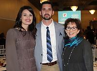 NWA Democrat-Gazette/CARIN SCHOPPMEYER Jennifer and Justin Wilhite (from left) and Vickie Boozman visit at Aiming for Zero.