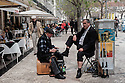 Lisbon, Portugal. 18.04.2016. Shoeshine man at work, Praca Dom Pedro V, Rossio, Lisbon. Photograph © Jane Hobson.