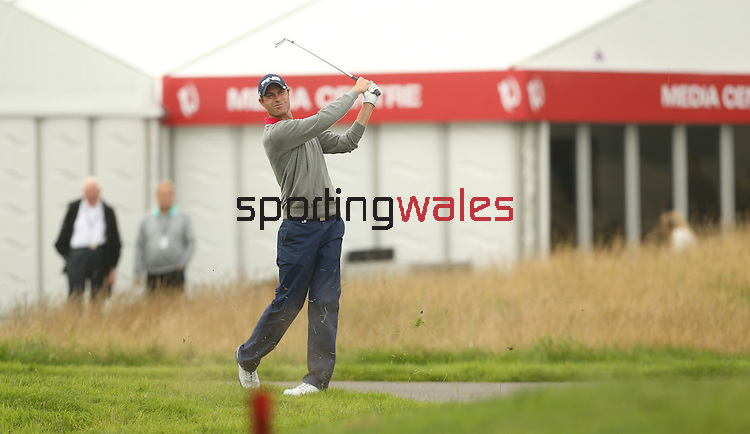 Welsh golfer Rhys Davies plays his second shot from close to the out of bounds on the first hole during the opening round of the ISPS Handa Wales Open 2013 at the Celtic Manor Resort<br /> <br /> 29.08.13<br /> <br /> ©Steve Pope-Sportingwales