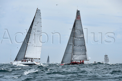 26.12.2015 Sydney, Australia. Rolex Sydney to Hobart Yacht race 2015. The rest of the fleet heads out to sea during the start of the 629 nautical mile race from Sydney to Hobart on Sydney Harbour.Triton from NSW type LC60 and Hollywood Boulevard from NSW type Farr 55.