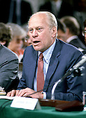 Former United States President Gerald R. Ford introduces Judge Robert Bork to the United States Senate Judiciary Committee in Washington, D.C. on September 15, 1987.  Bork was standing as President Ronald Reagan's nominee to be Associate Justice of the United States Supreme Court<br /> Credit: Arnie Sachs - CNP