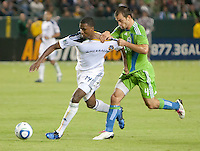 CARSON, CA – NOVEMBER 7:  LA Galaxy forward Edson Buddle (14) and Seattle Sounders defender Patrick Ianni (4) during a soccer match at the Home Depot Center, November 7, 2010 in Carson, California. Final score LA Galaxy 2, Seattle Sounders 1.