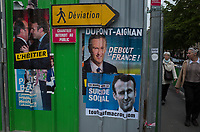 France. Ile de France. Paris. Partially torn campaign posters of French presidential election candidates<br /> Emmanuel Macron for the centrist party &quot;En Marche&quot; and Nicolas Dupont-Aignan for the right-wing party &quot; Debout la France&quot;. Posters on a construction site. 22.04.17 &copy; 2017 Didier Ruef