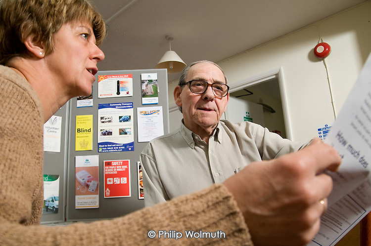 A resident receives advice from Gloucester Rural Community Council Village Agent Liz Davis, Western Way sheltered housing scheme, Dymock.