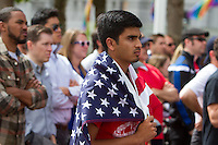 San Francisco, CA - Thursday, June 26, 2014:  USA soccer fan Mohammad Raza of Fremont watchs the USA vs. Germany first round World Cup match at a public viewing at the Civic Center in San Francisco, CA
