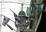 An Israeli flag beside the islamist movement flag in Jerusalem's Old City, Monday, Oct. 26, 2009. Hundreds of Israeli police patrolled Jerusalem's most volatile holy site on Monday, a day after fierce clashes with Palestinian protesters turned the hilltop compound into a battleground. The complex claimed by both Arabs and Jews was quiet Monday, but after weeks of sporadic violence around the site, police were on high alert . Photo by Mahfuz Abu Turk