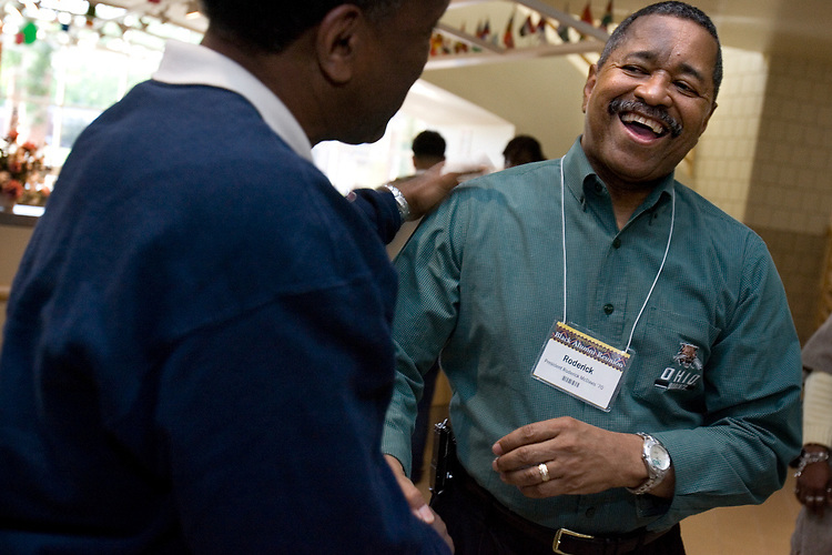 Ohio University president Roderick McDavis, right, greets Barry Northern with surprise during the university's Black Alumni Weekend dinner on Friday, 5/18/07. McDavis, graduated in 1970 with a bachelor's degree in social sciences in secondary education, floated through the crowd at the dinner with his wife, Deborah, more as a regular alumnus than with the status connected with his position as the university's president.