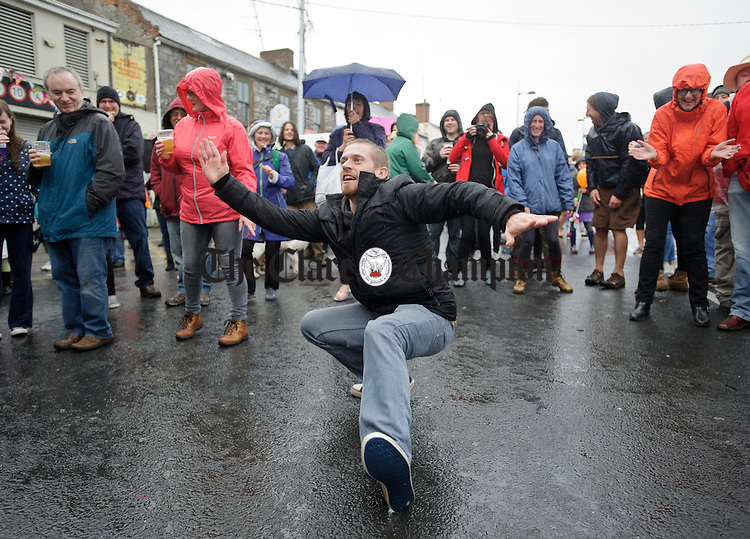 Roscommon's Niall Devanney dancing to the sounds of Skazz in The Market at Fleadh Cheoil na hEireann in Ennis. Photograph by John Kelly.