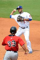 Chattanooga Lookouts second baseman Rafael Ynoa #5 attempts to turn a double play during a game against the Birmingham Barons on April 17, 2013 at AT&T Field in Chattanooga, Tennessee.  Chattanooga defeated Birmingham 5-4.  (Mike Janes/Four Seam Images)