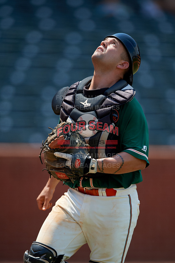 Greensboro Grasshoppers catcher Michael Hernandez (17) tracks a foul ball popup during a game against the Lakewood BlueClaws on June 10, 2018 at First National Bank Field in Greensboro, North Carolina.  Lakewood defeated Greensboro 2-0.  (Mike Janes/Four Seam Images)