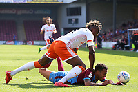 Blackpool's Armand Gnanduillet vies for possession with Scunthorpe United's James Perch<br /> <br /> Photographer David Shipman/CameraSport<br /> <br /> The EFL Sky Bet League One - Scunthorpe United v Blackpool - Friday 19th April 2019 - Glanford Park - Scunthorpe<br /> <br /> World Copyright © 2019 CameraSport. All rights reserved. 43 Linden Ave. Countesthorpe. Leicester. England. LE8 5PG - Tel: +44 (0) 116 277 4147 - admin@camerasport.com - www.camerasport.com