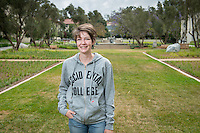 Occidental College grad Columbia Shafer '15 photographed at the entrance to campus, May 7, 2015.<br /> (Photo by Marc Campos, Occidental College Photographer)