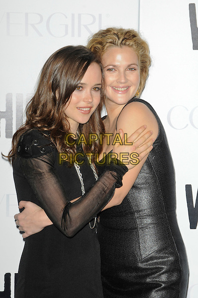 "ELLEN PAGE & DREW BARRYMORE .Attending the ""Whip It"" Los Angeles Premiere held At Grauman's Chinese Theatre, Hollywood, California, USA, 29th September 2009..half length black dress long sleeved sleeves sheer shiny arm around leather hugging director sleeveless .CAP/ROT.©Lee Roth/Capital Pictures"