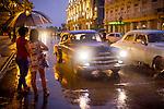 Havana, Cuba:<br /> Waiting for a taxi, rainy evening
