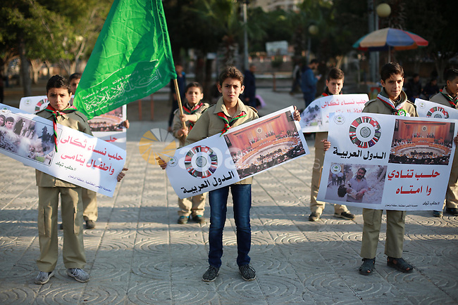 Palestinain Scouts take part in a protest to solidarity with the inhabitants of the embattled Syrian city of Aleppo, in Gaza city, on December 17, 2016. Photo by Mohammed Asad