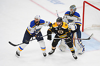 June 6, 2019: Boston Bruins left wing Jake DeBrusk (74) plays between St. Louis Blues defenseman Robert Bortuzzo (41) and goaltender Jordan Binnington (50) during game 5 of the NHL Stanley Cup Finals between the St Louis Blues and the Boston Bruins held at TD Garden, in Boston, Mass. The Blues defeat the Bruins 2-1 in regulation time. Eric Canha/CSM