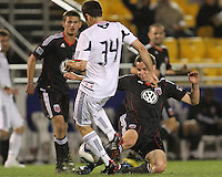 Conor Shanosky#17 of D.C. United tackles Mike Videira #34 of the Chicago Fire during a second round match of the Carolina Challenge on March 9 2011 at Blackbaud Stadium, in Charleston, South Carolina. D.C. United won 1-0.