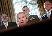 """United States President George W. Bush (2nd L) speaks as Donald Winter (L), Secretary of the Navy, General James """"Hoss"""" Cartwright (2nd R), Vice Chairman of the Joint Chief of Staff, and Dr. James B. Peake, Secretary of Veterans Affairs, listen as in the Oval Office of the White House December 5, 2008 in Washington, DC.  Bush signed two proclamations honoring World War II's Pacific theater.  <br /> Credit: Brendan Smialowski / Pool via CNP"""