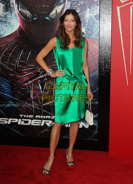 "Tricia Helfer.Los Angeles Premiere Of ""The Amazing Spider-Man"" Held The at Regency Village Theatre, Westwood, California, USA..June 28th, 2012.full length green silk satin dress hand on hip sleeveless .CAP/ADM/FS.©Faye Sadou/AdMedia/Capital Pictures."