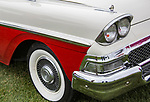 An antique car sits on a lawn.