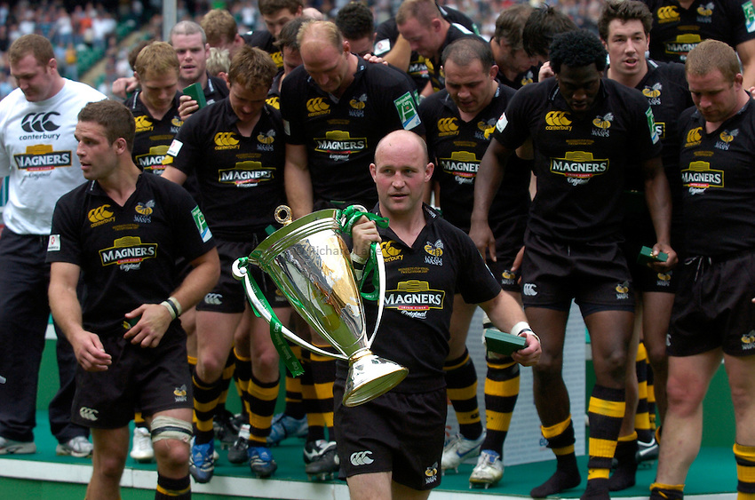 Photo: Richard Lane..London Wasps v Leicester Tigers. Heineken Cup Final. 20/05/2007..Alex King of Wasps celebrates with the trophy.