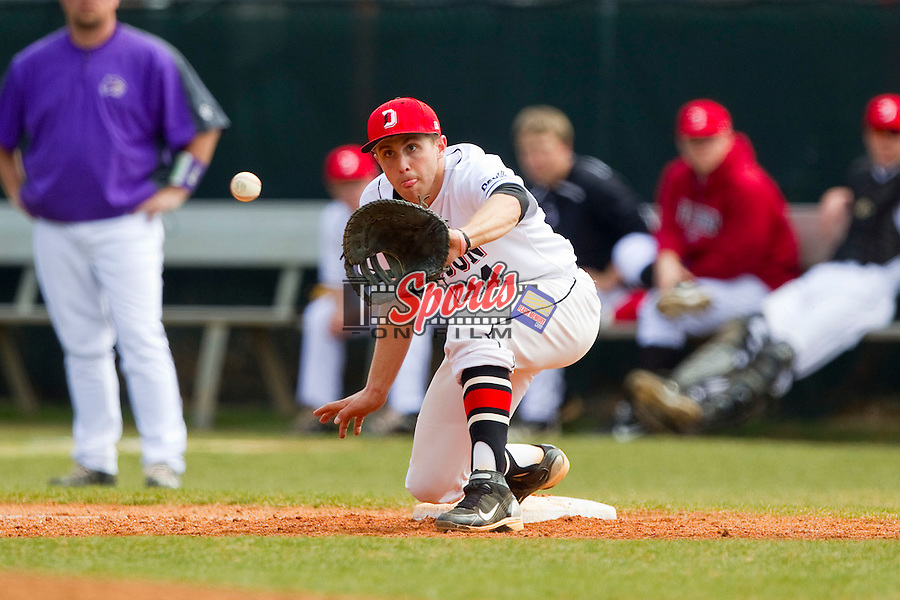 Davidson Wildcats first baseman Andrew Barna (24) stretches for a throw during the game against the Western Carolina Catamounts at Wilson Field on March 10, 2013 in Davidson, North Carolina.  The Catamounts defeated the Wildcats 5-2.  (Brian Westerholt/Sports On Film)