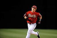 Apr. 8, 2008; Phoenix, AZ, USA; Arizona Diamondbacks shortstop Stephen Drew runs into third base with a ninth inning triple against the Los Angeles Dodgers at Chase Field. Mandatory Credit: Mark J. Rebilas-