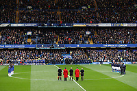 9th November 2019; Stamford Bridge, London, England; English Premier League Football, Chelsea versus Crystal Palace; Chelsea and Crystal Palace starting eleven and Referee Mike Dean stand with Chelsea Pensioners for a minute's silence to mark Remembrance Day before kick off - Strictly Editorial Use Only. No use with unauthorized audio, video, data, fixture lists, club/league logos or 'live' services. Online in-match use limited to 120 images, no video emulation. No use in betting, games or single club/league/player publications