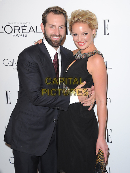 Josh Kelley & Katherine Heigl.18th Annual ELLE Women in Hollywood celebration held at The Four Seasons in Beverly Hills, California, USA..October 17th, 2011.half length black dress sleeveless silver gold beads beaded trim clutch bag suit beard facial hair arm around waist.CAP/RKE/DVS.©DVS/RockinExposures/Capital Pictures.