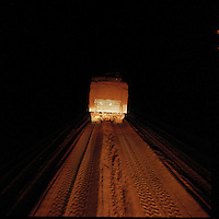 Sahara desert, Libya-Chad, November/December 2004..Every week, a convoy of 40 privately owned Libyan trucks loaded by the WFP with about 1000 metric tons of western food aid cross 2500 km of deep desert across Libya and Chad to reach more than 200 000 refugees from Darfur in camps near the Sudanese border. A large part of the trip his made very early in the morning or late at night as it is a lot easier detect the sand consistance in the dark than under a blazing sun.