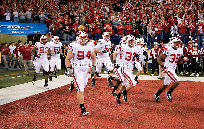 Wisconsin Badgers run onto the field during the NCAA Big Ten Conference Championship college football game against the Michigan State Spartans on December 3 , 2011 in Indianapolis, Indiana. The Badgers won 42-39. (Photo by David Stluka)