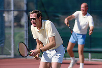 FREMONT, CA - Al Mangin and Jim Russell play tennis in 1987 in Fremont, California. (Photo by Brad Mangin)