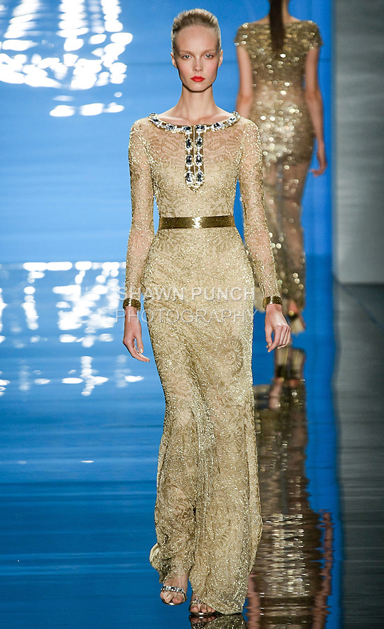 Kristy K walks runway in an outfit from the Reem Acra Spring 2013 ready-to-wear collection, during Merecedes-Benz Fashion Week Spring 2013 in New York City.