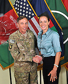 "Former Commander of International Security Assistance Force and United States Forces-Afghanistan General David Petraeus, left, poses for a photo with Paula Broadwell, co-author of  ""All In: The Education of General David Petraeus"" on July 13, 2011. The photo was made available on the International Security Assistance Force's (ISAF) Flickr website.  .Mandatory Credit: ISAF via CNP"