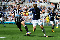 Harry Kane of Tottenham Hotspur battles with Ciaran Clark of Newcastle United during Newcastle United vs Tottenham Hotspur, Premier League Football at St. James' Park on 13th August 2017