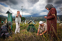 Fatima Davdieva (right) cries with family members at the grave of her mother who died after Fatima fled the country. Fatima, her husband, and their three children fled Grozny ten years ago during the Second Chechen War as refugees. Now as Belgian nationals they return for the first time to visit their friends, family and former home.