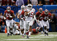 Ohio State Buckeyes running back Ezekiel Elliott (15) runs for an 85-yard touchdown in the fourth quarter of the Allstate Sugar Bowl college football playoff semifinal against the Alabama Crimson Tide at the Mercedes-Benz Superdome in New Orleans on Jan. 1, 2015. (Adam Cairns / The Columbus Dispatch)