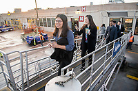 From left, Maggie Saucedo '22, Erin Kim '23 and Alejo Maggini '22 board their flight at Burbank Airport.<br /> Eleven Occidental College first-years and sophomores traveled with Career Services staff and Senior Associate Dean of Students Erica O'Neal Howard to San Francisco for a day to visit Cambridge Associates, managers of Oxy's endowment, as part of their workforce diversity initiative. They were invited to meet with employees (including two alums), tour the office, and learn about careers in investment management. Students were able to see how their quantitative courses could be applied to future career opportunities.<br /> January 17, 2020.<br /> (Photo by Marc Campos, Occidental College Photographer)