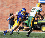 BROOKINGS, SD - SEPTEMBER 28:  Brock Jensen #16 from North Dakota State University looks for running room past T.J. Lalley #33 from South Dakota State University in the second quarter of their game Saturday afternoon at Coughlin Alumni Stadium in Brookings. (Photo by Dave Eggen/Inertia)