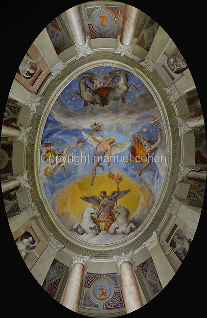 Ceiling fresco of Dawn, in the central Oval Room, with a figure of Twilight with 2 torches pointing to night and dawn, with the moon on a cart pulled by oxen, and Mercury holding the Caduceus, in the Villa Farnese or Villa Caprarola, a 16th century Renaissance and Mannerist fortified villa designed by Giacomo Barozzi da Vignola and built 1559-73 for the Farnese family under Cardinal Alessandro Farnese, in Caprarola, Viterbo, Lazio, Italy. The fresco was probably painted by Taddeo Zuccari, 1529-66, following an iconographic programme by Annibale Caro. The Villa Farnese is now owned by the state and run by the Polo Museale del Lazio. Picture by Manuel Cohen