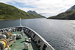 Hurtigruten ferry ship passing down fjord Raftsundet, Hinnoya Island, Nordland, northern Norway