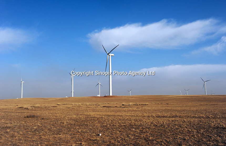 Wind turbines on the plains 30 kilometers from Bayan Obo, Inner Mongolia. .