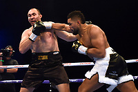 Joe Joyce (white/black shorts) defeats Alexander Ustinov during a Boxing Show at Stevenage Football Club on 18th May 2019
