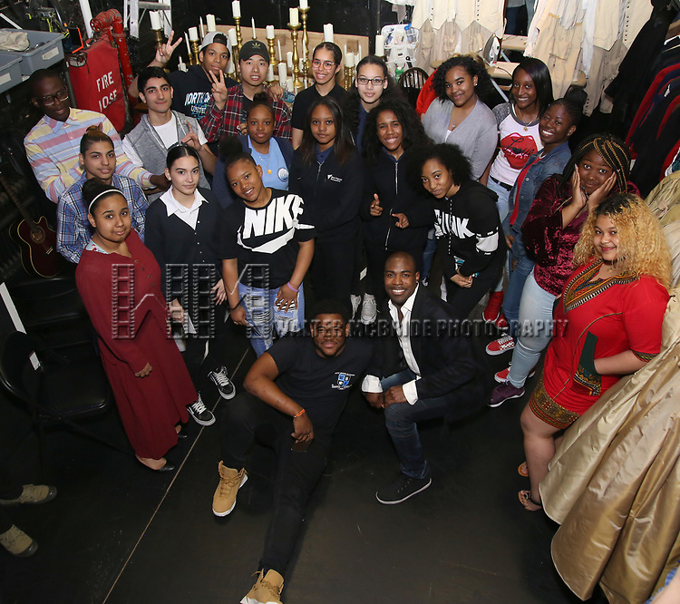 """Justin Dine Bryant with High School performers during a Q & A before The Rockefeller Foundation and The Gilder Lehrman Institute of American History sponsored High School student #eduHam matinee performance of """"Hamilton"""" at the Richard Rodgers Theatre on May 9, 2018 in New York City."""