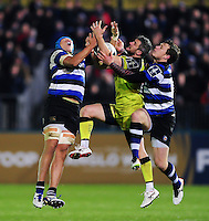 Tom Brady of Leicester Tigers competes for the ball in the air with Zach Mercer and Jack Wilson of Bath Rugby. Anglo-Welsh Cup match, between Bath Rugby and Leicester Tigers on November 4, 2016 at the Recreation Ground in Bath, England. Photo by: Patrick Khachfe / Onside Images