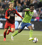 Seattle Sounders Obafemi Martins (9) controls the ball away from Portland Timbers Gaston Fernandez (10) during an MLS match on April 26, 2015 at CenturyLink Field in Seattle, Washington.  Seattle Sounders Clint Dempsey scored a goal to give the Sounders a 1-0 victory over the Timbers. Jim Bryant Photo. ©2015. All Rights Reserved.