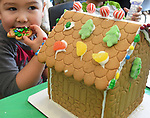 Ian Nero, 5, of Somers, found out the best part of making a gingerbread house is the construction material are eatable, and delicious too, during a well attended gingerbread house making event, Saturday, December, 16, 2017, at the Somers Library, some 40 kids and parents took part. (Jim Michaud / Journal Inquirer)