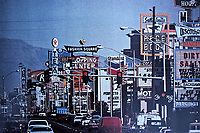 Las Vegas:  Las Vegas Strip. Signage overwhelming street.  October 1987.